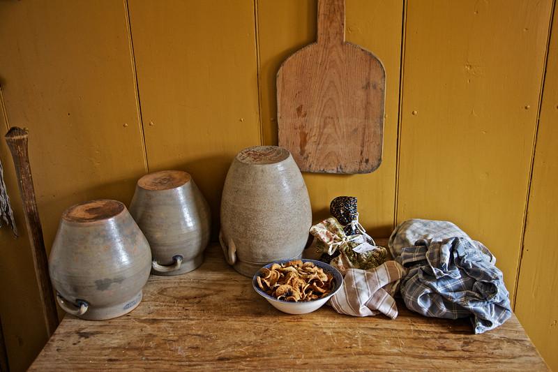 Nineteenth Century Daily Life:  Kitchen Crocks and Dried Fruit Slices. Freeman Farm, c. 1800-1810. Old Sturbridge Village, Worcester County, Massachusetts