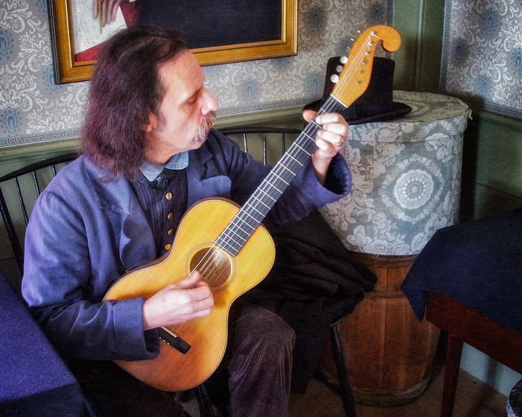 Nineteenth Century Daily Life: Walter Buckingham playing a 19th Century Reproduction Guitar, Old Sturbridge VIllage, Sturbridge, Worcester County, Massachusetts