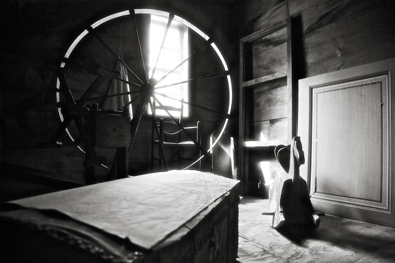 Colonial Era Daily Life:  Attic Storage With Spinning Wheel, Trunk and Wooden Rocking Horse. Parsonage, c. 1748. Old Sturbridge Village, Worcester County, Massachusetts