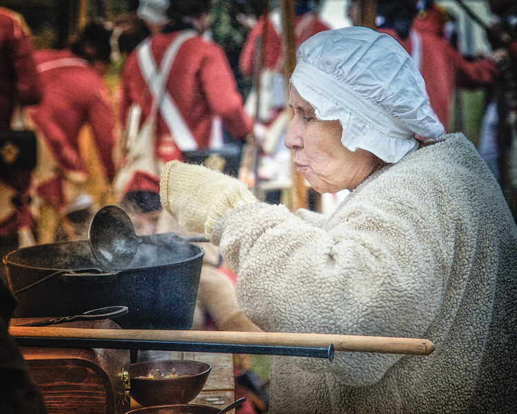 Older Woman in Colonial Era Costume Cooking for British Troops. Burning of Kingston Revolutionary War Reenactment, Kingston, Ulster County, New York