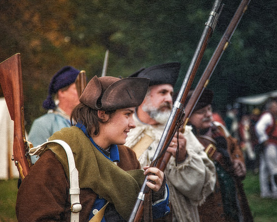 Colonial Reenactors in Uniform with Muskets. Burning of Kingston Revolutionary War Reenactment, Kingston, Ulster County, New York