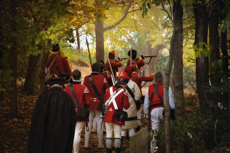 British Troops Firing in Autumn Forest. Burning of Kingston Revolutionary War Reenactment, Kingston, Ulster County, New York
