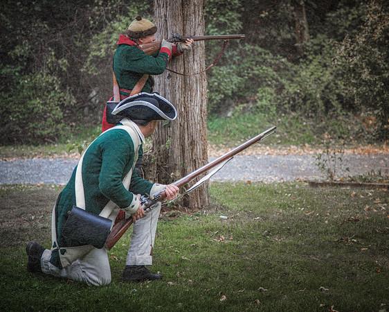 Two Colonial Reenactors in Green Uniforms. Burning of Kingston Revolutionary War Reenactment, Kingston, Ulster County, New York
