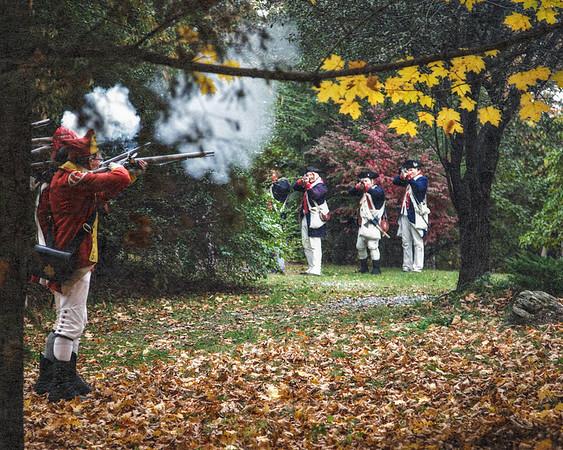 British Line Firing At Colonial Line. Burning of Kingston Revolutionary War Reenactment, Kingston, Ulster County, New York