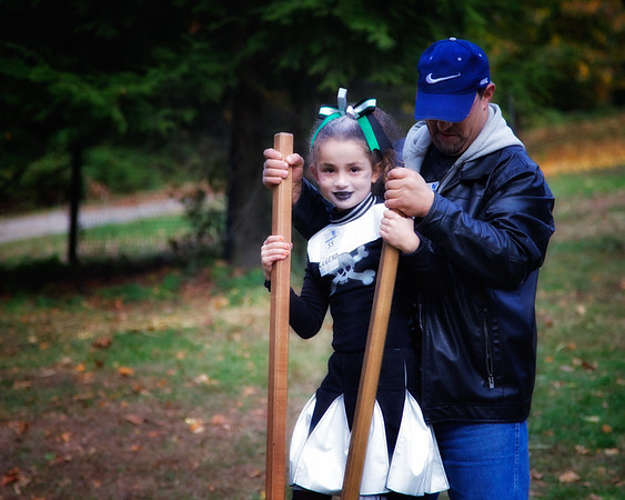 Young Girl with Painted Face and Costume and Her Father on Stilts at Legend Weekend. Sunnyside, formerly Wolfert's Roost, Home of Washington Irving, Irvington, Westchester County, New York