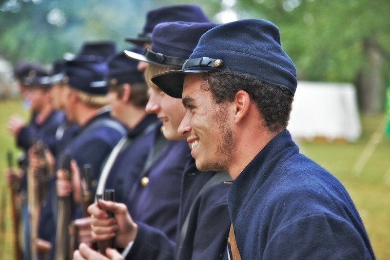 Civil War Reenactments: Closeup of Faces of Union Soldiers Laughing While Standing At Attention. Princeton Civil War Day, Princeton, Gibson County, Indiana