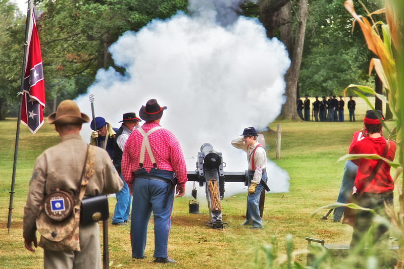 Civil War Reenactments: Confederate Soldiers Fire Cannon With Smoke Towards Union Line in Battle, Princeton Civil War Day, Princeton, Gibson County, Indiana