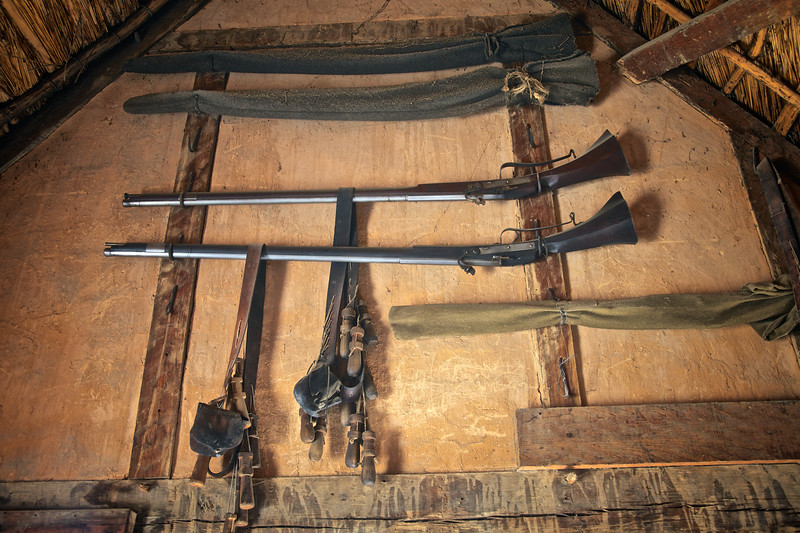 Colonial Era Muskets Hanging on the Wall of a Home