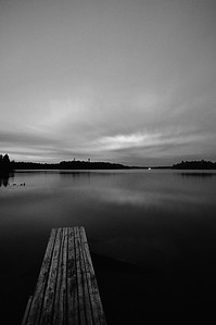 Boat dock after dusk on Big Lake, Wisconsin. Converted to black and white.