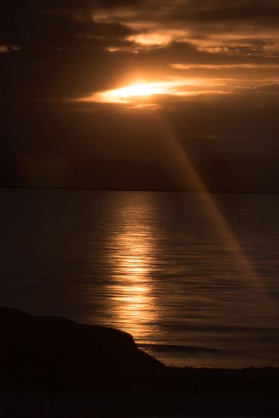 Sun Setting Behind the Clouds Over the Great Salt Lake