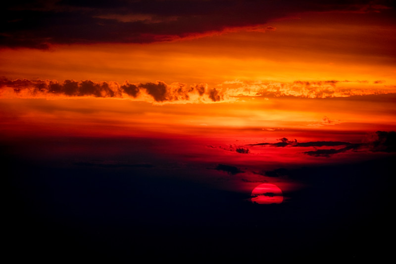 Sunsetting behind clouds