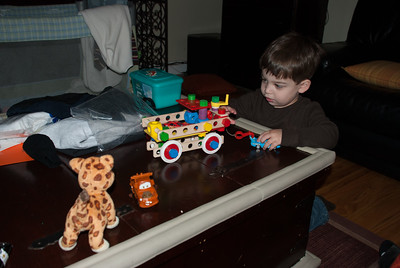 Lucas enjoys his new tow truck from Oma/Opa (with King Blue, Mator and Baby Jaguar)