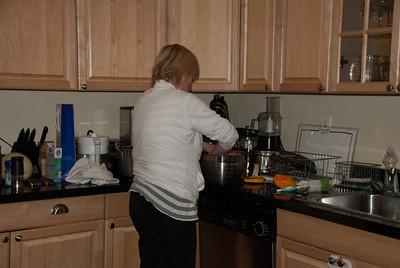 Oma working the pumpkin flesh
