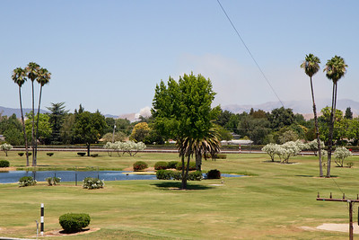 Fire in distance. Golf course in the center of the Alameda County Fairgrounds racetrack.