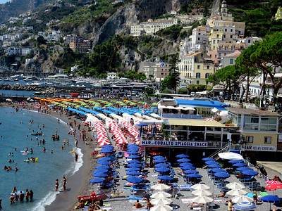 Amalfi. Not white and sandy like we tend to think about beaches, but Italians will plant an umbrella (or several 100) almost anywhere the ocean meets the shore.