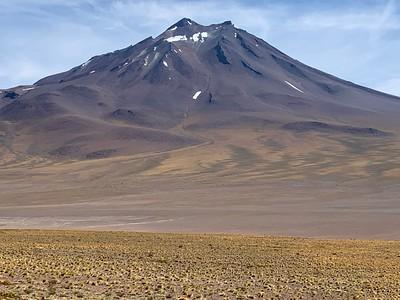 An extinct volcano looms over the desert.