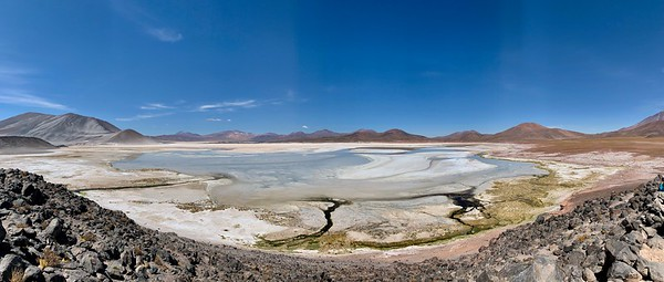 A salt flat, where the water has all but dried up.