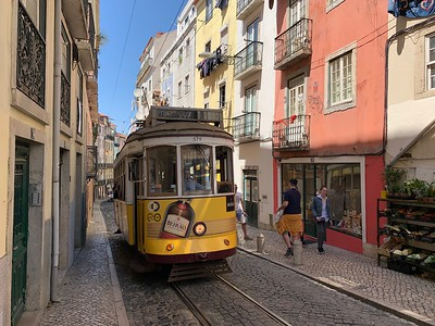 Sharing the narrow streets of Lisbon with a street car
