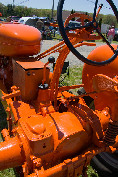 This is a closer shot of the controls of that orange monster from the previous shot. One hell of a bright orange paint job.  Taken at Antique Engine and Tractor Show - Somers, CT, US