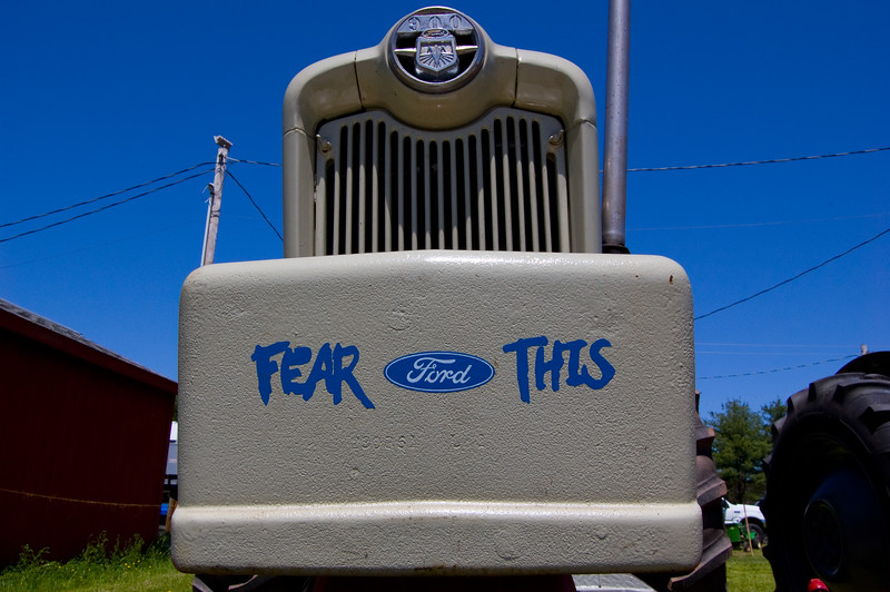 "The sky was terribly cooperative that day. I tried to capture an angle that embodied the ""Fear This"" slogan... I think the next shot captured it better.  Taken at Antique Engine and Tractor Show - Somers, CT, US"