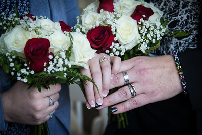 Showing off our rings and lovely floral arrangements