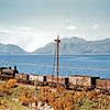 Ex-Caledonian Railway '294' Class (LMSR Class 2F) 0-6-0 No  57276 stands by the shore of Loch Linnhe near Kentallen with a permanent way maintenance train during May 1957  [Colour-Rail]