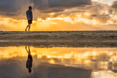 Reflection of beach goer at Byron Bay Beach.