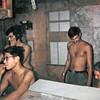 FDC Bunker LZ Liz:  Glen Hirabayashi smoking, Bob Mazza on radio, Nick Kennedy standing, Doug Clearwater far right.