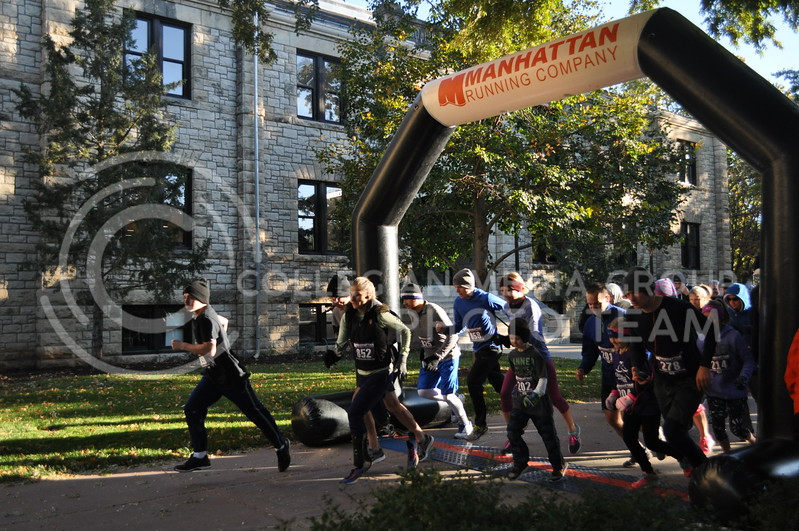 Runners in the C. Clyde Fun Run take off the morning of Oct. 28, 2017 in front of Seaton Hall. The 5K fun run and Midge's Mile Fun Walk was held to raise money for Shepherd's Crossing, a community charity that helps residents pay bills and rent when they are in hard times.