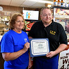 C & M Pizza of Leominster celebrated 55 years in business with a ribbon cutting on Tuesday morning, March 19, 2019. for the entire day they had slices for 55 cents. Owners Debbie Chesbrough and her son Andy Sears hold up a certificate they got from the city for their 55 years in business. They have been in this spot on Central Street since 1970. SENTINEL & ENTERPRISE/JOHN LOVE