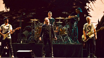 U2 performs  at Popa Johns Stadium in Louisville , Ky