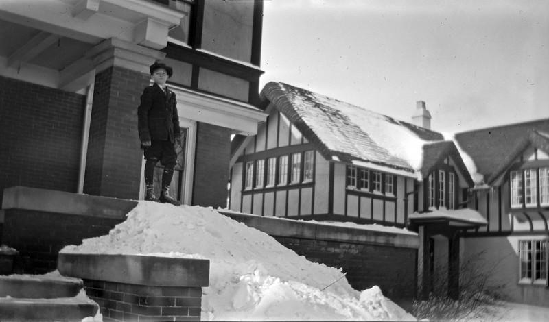 #117 George Stebbins on 109 N Walnut porch atop snowslide December 1917