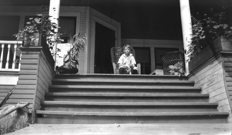 86 George A Stebbins in chair at top of Roaring Brook's front porch steps 1917