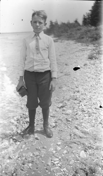 #42 George GAS Stebbins - holds box camera on rocky beach 1919