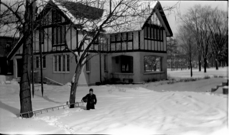 #62 George GAS knee deep in snow by Stowells house next to 109 N Walnut Lansing winnter 1920