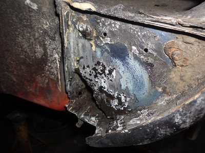 Left front sill end holed