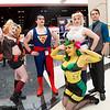 Harley Quinn, Superman, Poison Ivy, Power Girl, and Bruce Wayne