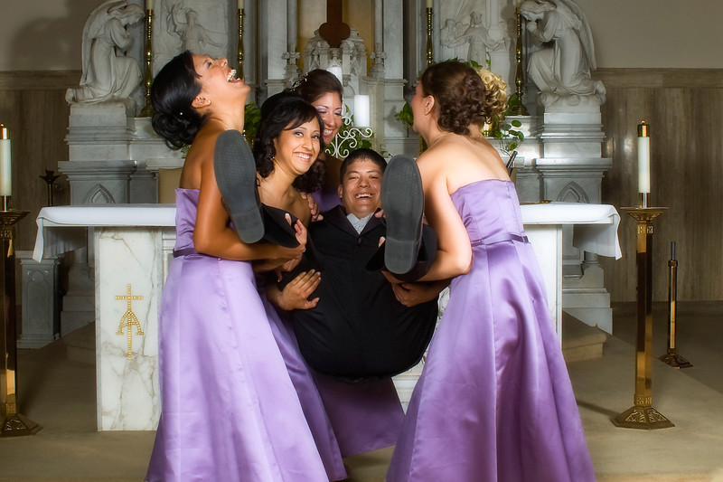 The bridesmaids having a little too much fun with the groom