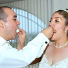 The bride and groom feed each other some wedding cake