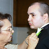 Mom fixing the boutonniere on Chris