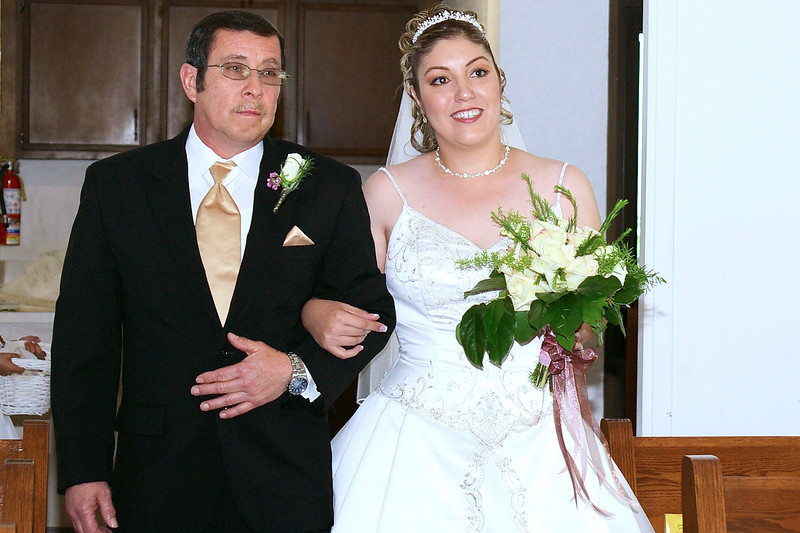 Dad walking the bride down the aisle