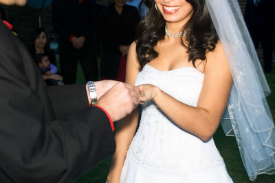 Putting on the ring on her hand