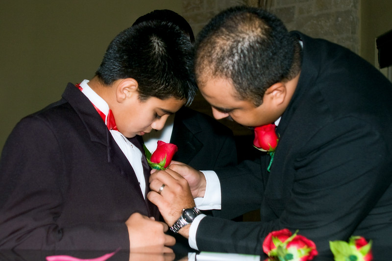 Helping a little man with his boutonniere
