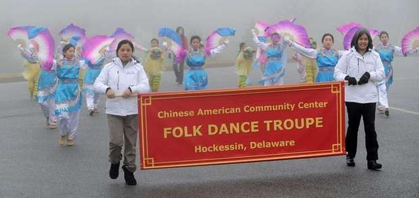 1/13/13 HOCKESSIN, DE - WIL 0118 Chinese Dance Troupe - Qiong Cheng (left) and Kanchalee Reeves carry the banner of the Chinese American Community Center Folk Dance Troupe during practice for their performance in the presidential inauguration parade January 21. GARY EMEIGH/THE NEWS JOURNAL