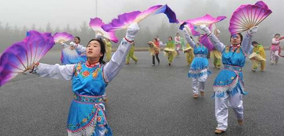 Josephine Chu (left) practices the Dance of the Golden Snake with the Chinese American Community Center Folk Dance Troupe for their performance in the presidential inauguration parade Jan. 21.