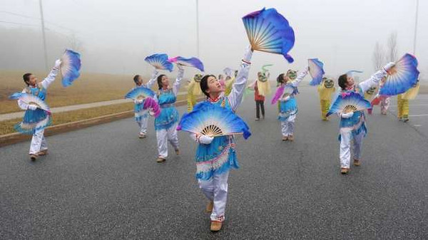 Josephine Chu (center) practices with the rest of the Chinese American Community Center Folk Dance Troupe for their performance in the presidential inauguration parade Jan. 21. They will perform the Dance of the Golden Snake.