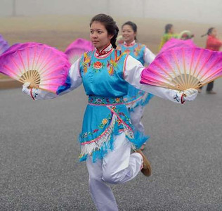 Chinese American Community Center Folk Dance member Dana Holloway practices with the rest of the troupe for their performance in the presidential inauguration parade Jan. 21.