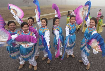 The Chinese American Community Center Folk Dance Troupe poses during practice for their performance in the presidential inauguration parade Jan. 21.