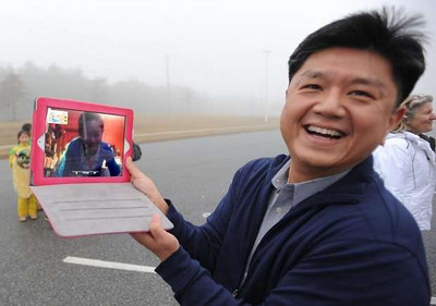 Steve Hu Skyped with choreographer Ling Tang in New York so she could watch the Chinese American Community Center Folk Dance Troupe practice their Dance of the Golden Snake routine. They plan to perform in the presidential inauguration parade Jan. 21.