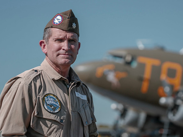 "An Airborne trooper with C-53 aircraft ""Southern Cross"" in the background."